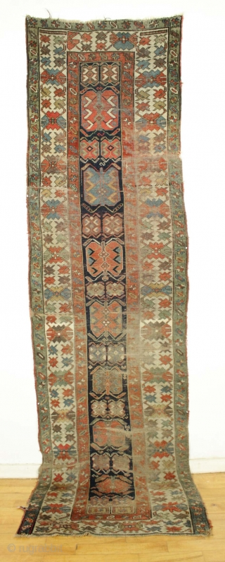 """Antique long rug. Northwest persian? Small band of white cotton pile across the field shown in pic. Offered """"as found"""", very very dirty with low pile,  wear, tears. patches, etc. Appears  ..."""