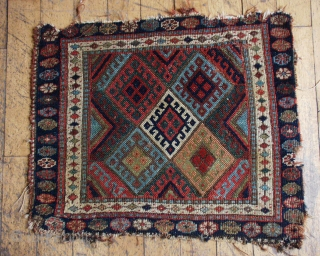 """Antique jaff Kurd bagface. Unusual and beautiful all natural colors. Rough condition with low pile and edge issues. 22"""" x 25"""""""