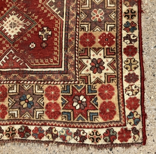 """Antique Turkish melas rug with an interesting design featuring a lovely """"star"""" border. Good age and good old colors but not good condition. Substantial wear and damage with many holes in field.  ..."""
