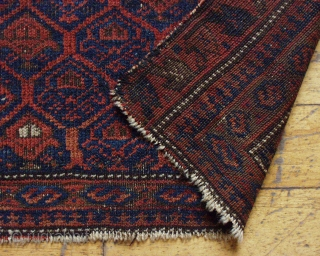 "Antique Baluch bagface. Another ""shrub"" bag. ""as found"", Low pile, border loss, small nibble. Good colors. 16"" x 23"".."