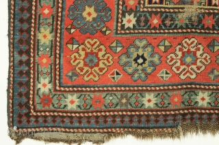 Early caucasian rug fragment. Beautiful drawing and world class color. All natural colors featuring a terrific yellow ground, real purples, rich greens and 2 reds. Thin with mostly good even low pile  ...