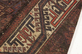 antique baluch rug with an interesting archaic waisted diamond lattice design. Colorful ivory ground turkman line border. As found, very very dirty with scattered old damage and wear as shown. Interesting study  ...
