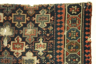 Old tribal mystery rug fragment. Northwest Persian? I don't know what it is but I like it. All good natural colors including a fine grape purple. Very dirty and damaged as shown.  ...