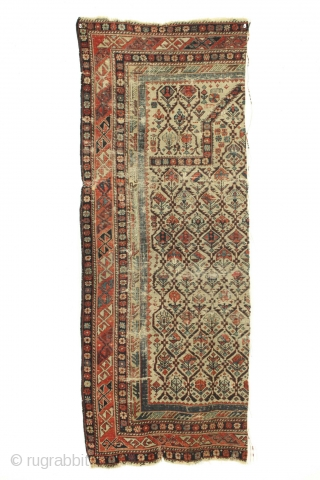 Antique caucasian shirvan prayer rug fragment. Almost half the rug. All good natural colors. Old piece with great variety of plant designs in the lattice. Very very dirty. All manner of damage  ...