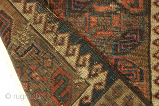 """Antique baluch rug fragment. Rare design. All good natural colors. Edge damage all around, small old repairs, moth nibbles, small tears. Just had a quick wash. Good age, ca. 1880 or earlier.19""""  ..."""