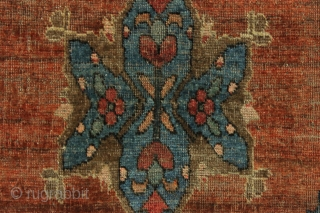Is it a butterfly? is it a flower? it's supermat. Not really, but an unusual little south persian mat. Interesting medallion and an earthy palette with uneven abrashed field. Lots of natural  ...