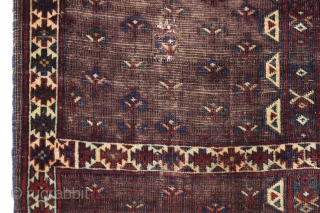 Antique yomud ensi or small rug. Unusually spacious drawing and interesting end panels. Rich deep purple ground and all natural colors. Wear, corrosion, damage as shown. Washed. Glossy wool. Difficult to photograph  ...