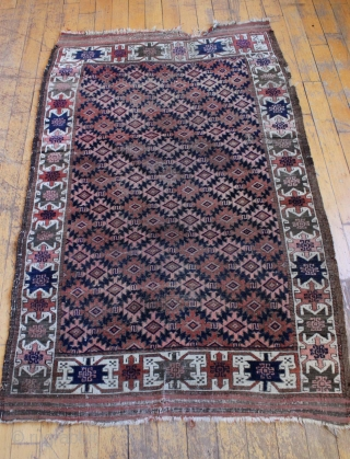 "Antique Baluch rug. Unusual ivory border. Mostly good even low pile. Couple tiny holes. Original ends and sides. Clean. 3' 7"" x 5' 9"""