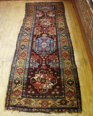 ANTIQUE VERAMIN LONG RUG.  NICE DESIGN.  MOSTLY GOOD PILE.  ALL NATURAL COLORS FEATURING PRETTY LIGHT BLUES.  SOME SCATTERED WEAR, ROUGH ENDS AND EDGES, OLD MOTH NIBBLES.  JUST  ...