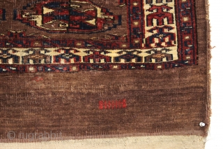 Antique turkoman chuval. Dark and strange but I find it oddly attractive. I like the border. Mostly decent low pile as shown. Unusual pallete but all natural, no dye run. Original back.  ...