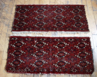 Antique original pair of Tekke torbas. From a New England estate. High quality wool. All good saturated natural colors. Some magenta silk highlights. Some wear as well as edge and side damage.  ...