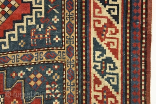 Antique small kazak rug. Charming little karachopf long type variant. All natural colors with lots of nice old greens. Decent overall condition with good edges and ends. Mostly good pile, a bit  ...