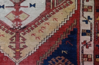 Konya Karapinar Fragment, 170x132 cm. Attached to linen. This damaged and worn 19th c. fragment is remarkable because of the uniqueness of the central emblem, from Turkoman origins.