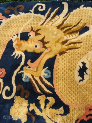 "Chinese dragon rug (#857) 3' 7"" x 8' 1""; large gold dragon in clouds on indigo field, excellent condition, 20th century."