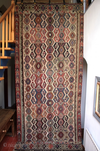 Finely woven 19th east Anatolian kilim with good colours complete with full borders at both ends, some corroded weft, old faded repairs and minor holes; a worthwhile restoration project. Size 386x160cm. Unusual  ...