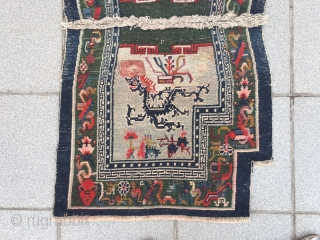 """Tibetan horse saddle rug, rare green background with double dragon pattern, Buddha eight treasure selvage. About 80years old. Good condition. Size 115*60cm(45*23"""")"""