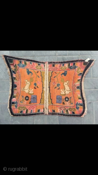 """Tibetan butterfly horse saddle, about mid Qing Dynasty. Orange background with snow  mountain lion veins. Good age and condition. Size 120*74cm( 47*29"""")"""