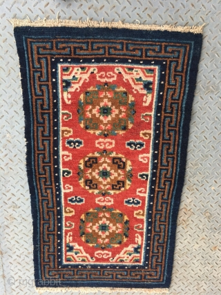 """Tibet rug, red color, three medallions flower pattern around lucky cloud veins. good colors and condition, good age , 4 rows of knots rewoven at one end. Size 133*73cm(52*28"""")"""