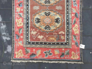 """Tibet rug, camel background with three group flowers pattern, around red color full flower selvage. Size 152*83cm(59*32"""") wool warp and weft. Good age"""