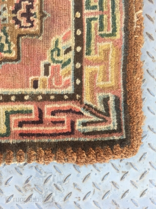 Tibetan square rug, single cross shape flower around lucky cloud veins. Very beautiful colorful and good quality. Wool warp and weft. Tightly row knots. Very good age. Size 68*68cm