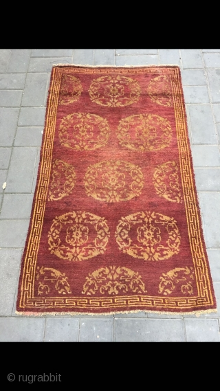 "Tibet rug, red background with medallion flowers , good age and condition. Size 90*155cm(35*60"")"