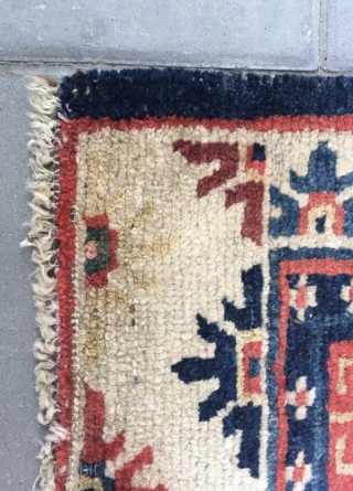 "Tibet rug, blue background with nice flowers . Good age and condition. Wool warp and weft.size 63*75Cm(25*29"")"
