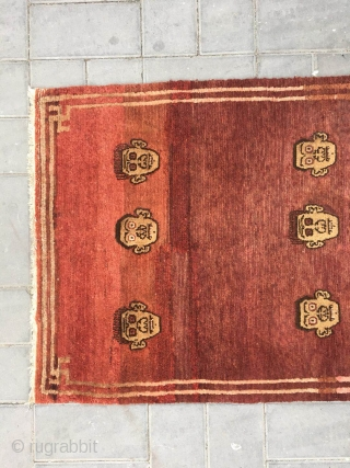 Tibetan rug, red  background with skeleton head veins. Size 152*80cm. Good age and condition, wool warp and weft. The wool have a little  nature color cutting .