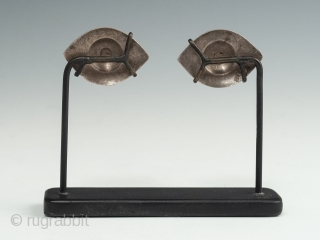 """Silver eyes, China or India. 1.25"""" (3.2 cm) wide each, 2.75"""" (7 cm) high, as based Late 19th to early 20th century. Ex. Cathryn Cootner, Sonoma. These mesmerizing inlaid eyes once likely adorned  ..."""