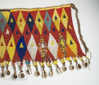 "Pikuran (cache-sexe), Bana Guili people, Mandara Mountains, Cameroon. Seed beads, cotton string, cowrie shells, 19"" (48.3 cm) wide by 9.5"" (24 cm) high, mid 20th century or earlier.