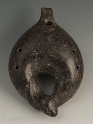 """Ocarina in the shape of a serpent, Colima, West Mexico, Terracotta, Ca. 100 B.C. to 250 A.D., 6.5"""" (16.5 cm) long by 4.5"""" (11.4 cm) wide. Ocarina in a curled serpent form  ..."""