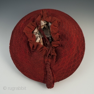 """Woman's hat, Isicholo, Zulu people, South Africa. Cotton, wire, 11"""" (28 cm) in diameter by 3"""" (7.6 cm) high, Mid 20th century. The unusual spiral weave on this cotton Isicholo makes this a  ..."""