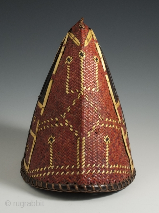 "Hat, Naga People, Kalyo-Kengyu eithnic group, Northeastern India. Cane, orchid straw, 8″ (20 cm) high by 8.25″ (21 cm) by  5.5"" (14 cm). A red-dyed woven cane conical-shaped warrior's hat has  ..."