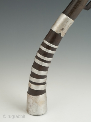 "Rice cutter, Khymer culture, Cambodia. Horn, aluminum, iron, 10.5"" (26.6 cm) high, 22"" (56 cm) wide. Mid-20th century. The gracefully curved part of the ox horn was used to gather a handful  ..."