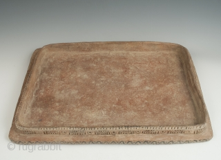 "Game board, Chachapoyas, Northern Peru. Earthenware, slip. 900 to 200 BCE. 13"" (33 cm) high by 9"" (23 cm) wide"