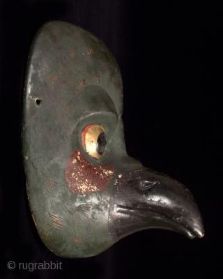"Karasu (crow) Tengu mask, Japan. Kiri wood, pigments, gold leaf. 6.75"" (18 cm) high by 6"" (14 cm) wide. Late Edo-early Meiji, 19th century.  This bird mask represents Karasu Tengu, a mythical demon fighter who trained  ..."