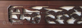 Antique Japanese Ranma (transom) Antique Japanese wood ranma (transom) with a black lacquer frame. The center panel carved with a Shinto gate (torii) and temple lantern in a forest of pine trees.   Dimensions:  ...