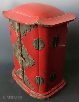 Japanese Red Lacquer Zushi Traveling Buddhist Shrine Japanese Buddhist Zushi (portable shrine) with bright red lacquered wood exterior and gilt interior. Shrine with the statue of sitting Fudo Myoo, the fierce deity with  ...