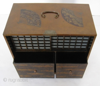 Stunning Antique Japanese Lacquered Case  Beautiful Japanese light colored gold guilt lacquered case with fans. There are six fans with cranes, landscape scenes, and fruit. Original brass hardware has a lovely scrolling design.  ...
