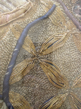 Japanese Woven Textile Of Ebisu and Daikoku    Amazingly beautiful antique Japanese textile in a black wooden frame, with a background of ivory-colored cloth with light blue and yellow sewn birds and cloud-like designs  ...