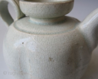 Antique Chinese Qingbai Porcelain Teapot  Chinese qingbai ware porcelain teapot with a ribbed melon shape body, short flat spout and spiraled handle. The mouth is flared with a thin and short neck. The  ...