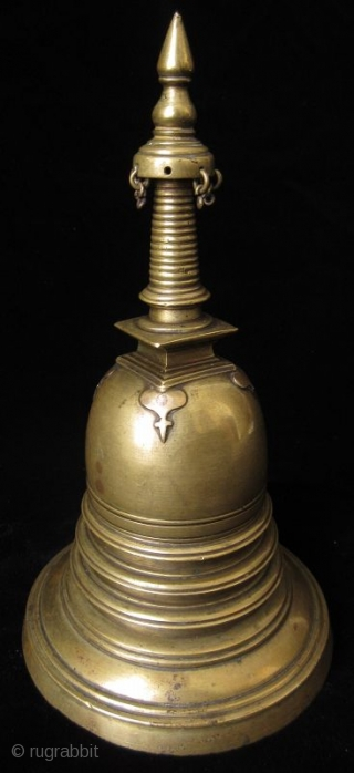 Antique Reliquary Gilt Bronze Stupa  Southeast Asian gilt bronze stupa consisting of two parts that may be opened when a secret mechanism is activated. The domed Bumpa is supported by circular terraces and  ...