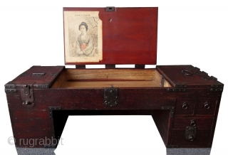 Rare Japanese Low Shop Desk Tansu  Unusual Japanese hardwood low shop desk tansu. Original red lacquer finish with heavy iron plates and mounts. The table surface is hinged with three doors that open  ...