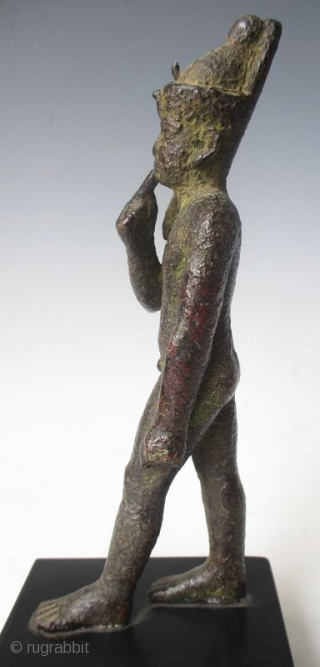 Rare Antique Egyptian Bronze Walking Nobleman  Rare Antique bronze figure of a nude nobleman in walking pose, his pointer finger of his right hand resting up against his chin, with green patina and  ...
