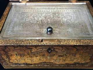 18th Century Antique Chinese Lacquered Tea Box  A delicate antique Chinese Tea Box with exquisitely decorated gilt relief. It has a pewter box lining with a glass knob. The lacquer shows images of  ...
