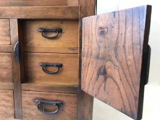 Antique Japanese Choba Tansu An antique Japanese Choba (merchant) Tansu of hinoki wood and iron hardware. The top section has one large drawer with two handles. The middle section has two sliding doors  ...