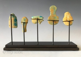 Rare Faience Egyptian Amulets  Five clay faience (blue -green) amulets from Egypt that are mounted on a custom stand. The amulets are a Pharaohs head, a sphinx, a Wedjat eye (Eye of Horus),  ...