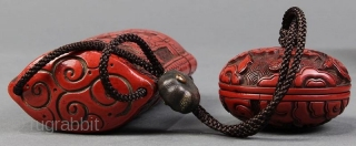 Antique Carved Cinnabar Lacquer Inro w/Manju  An exquisite hand-crafted Japanese cinnabar lacquered Inro with five compartments and Manju. It has a meticulously carved scene with 2 scholars or sages on one side and  ...