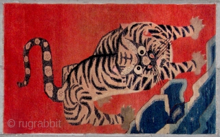 "No.CL060 * Chinese Antique ""Tiger "" Rug.Age: Late 19th Century.Size: 100x162cm ( 3'3"" x 5'4"" ).Origin: Baotou-Suiyuan. Shape: Rectangle.Background Color: Reds. A heroic bearing tiger is setting off. This rug was probably  ..."
