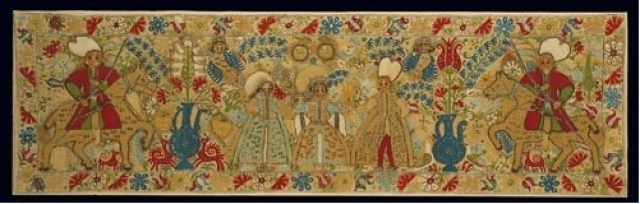 Bridal cushion with wedding scene. From Ioannina in Epiros. It depicts the bride with her parents and the groom with his friend, both on horseback. The riotous floral ornaments, the attractive multi-coloured scenes, and the harmonious execution of the compositions with their distinctly painterly qualities are, from every point of view, characteristic of Epirot embroidery. 17th c. 0.40x1.40 m. Gift of Helen Stathatos. (ΓΕ 21173) image and text copyright Benaki Museum, Athens